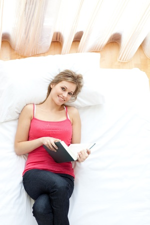 Smiling woman reading a book  photo