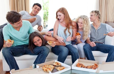 Adolescents eating pizza at home Stock Photo - 10074236