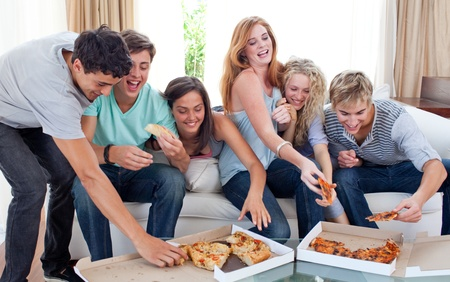 Friends eating pizza at home photo