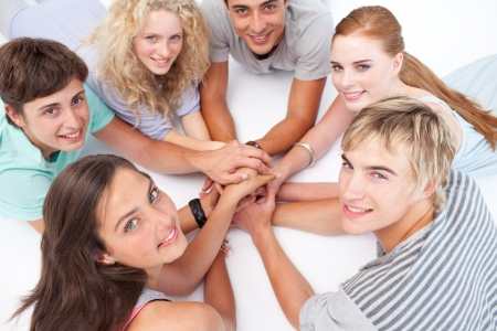 Teens playing on the floor hands games photo