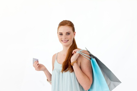 Beautiful teenager with shopping bags photo