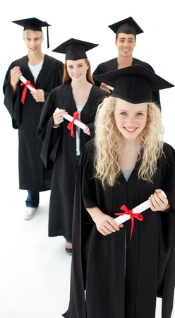 Smiling group of teenagers celebrating after Graduation photo