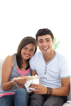 Couple of teenagers eating pasta with copy-space photo