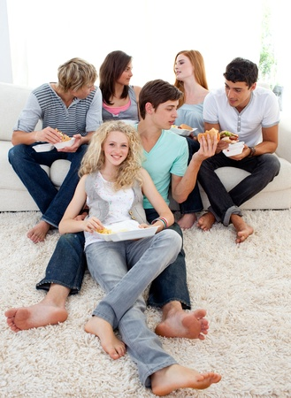 Teenagers eating burgers and fries photo
