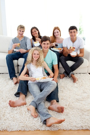 Friends eating burgers and fries Stock Photo - 10075643