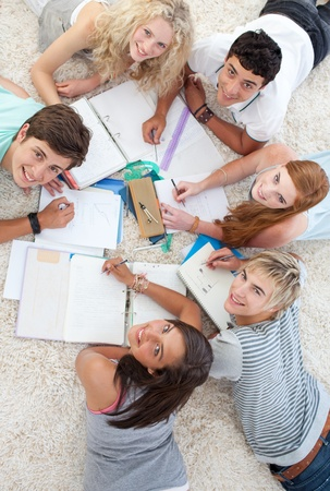 Group of Teenagers studying together photo