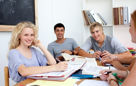 Teenagers studying in the library Stock Photo - 10073937