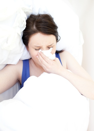 Sick young woman relaxing in her bed Stock Photo - 10071912