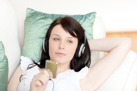 Beautiful young woman listening music with headphones  photo