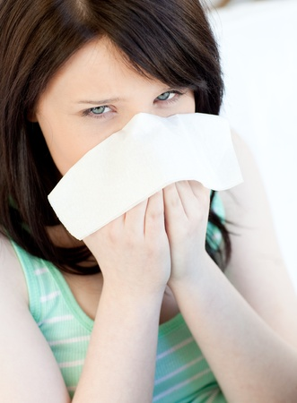 Portrait of a sick caucasian teen girl blowing Stock Photo - 10074048