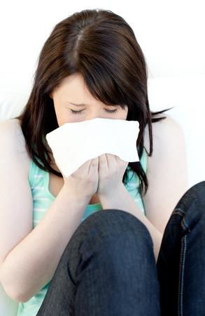 Portrait of a sick brunette woman blowing  photo