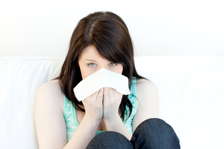Portrait of a sick attractive woman blowing Stock Photo - 10073601
