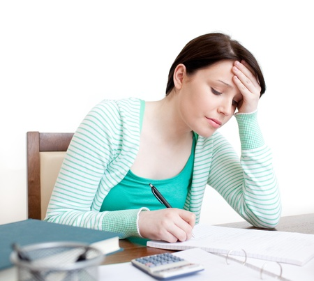 Tired student doing her homework Stock Photo - 10072285