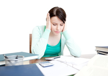 Stressed student doing her homework Stock Photo - 10072263