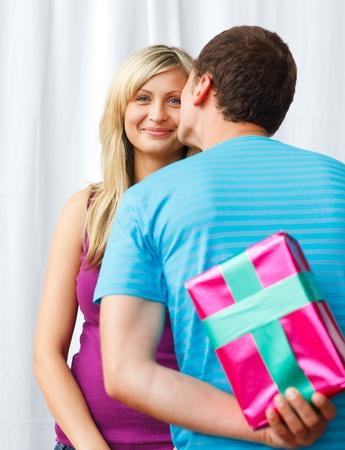 Attractive boyfriend giving a present  photo
