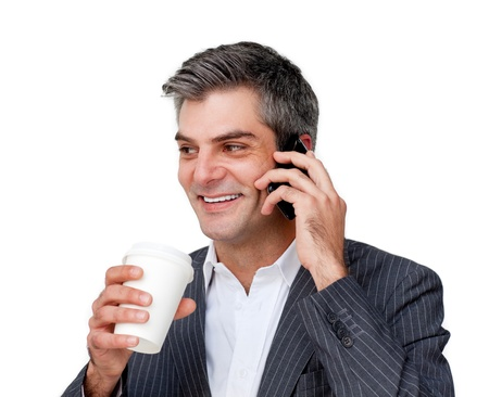 Smiling businessman talking on phone and drinking coffee photo