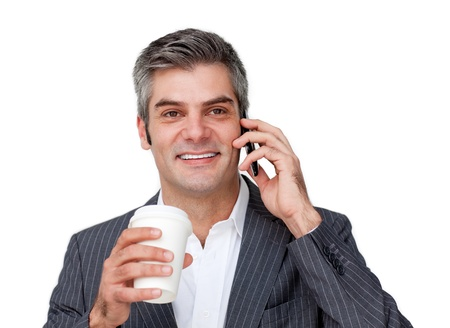 A businessman talking on phone and drinking coffee photo