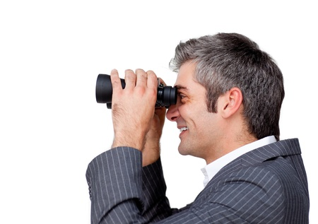 binoculars: Serious businessman using binoculars