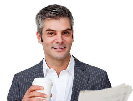 Charming businessman drinking coffe photo