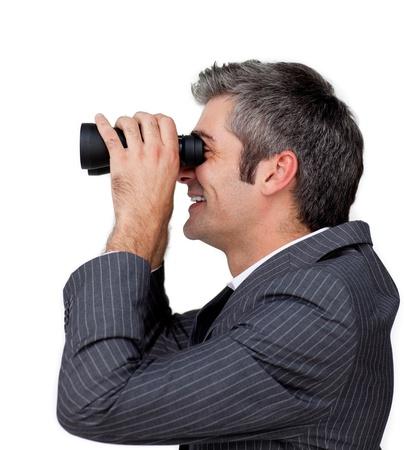 Businessman using binoculars  photo