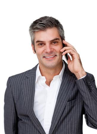 Confident mature businessman talking on phone photo