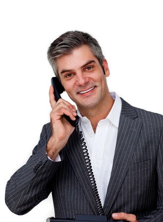 Assertive businessman using a mobile phone photo
