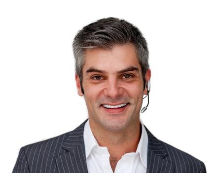 telephone headsets: Empresario atractivo hablando sobre un auricular  Foto de archivo