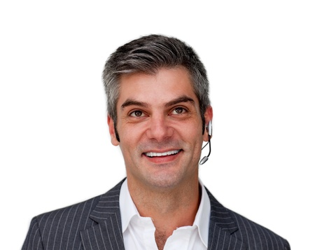 Assertive businessman using headset Stock Photo - 10071731