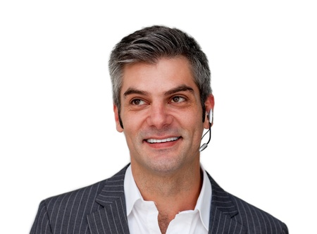 Smiling businessman with headset on photo
