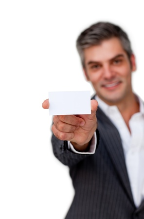 Positive businessman showing a white card  photo