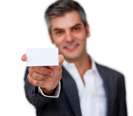 Charismatic businessman showing a white card  Stock Photo - 10071740