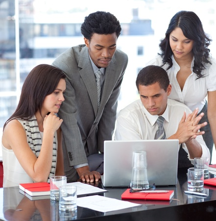 Business team working together with a project Stock Photo - 10073412