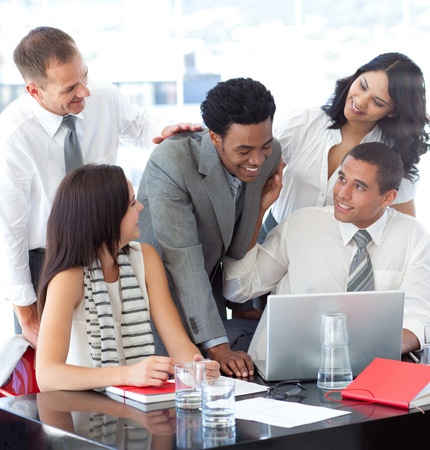 Successful business team working together in office photo