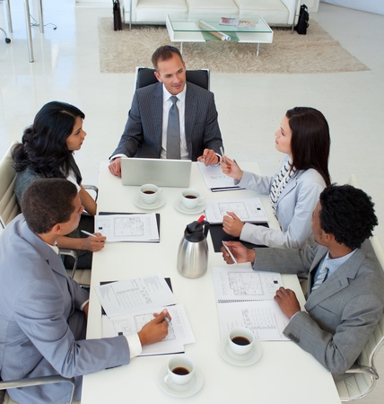 High angle of business people discussing in office a plan photo