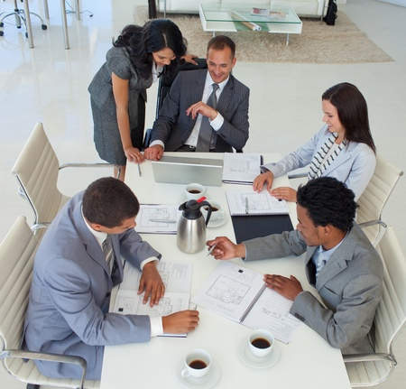 High angle of business people working in a meeting photo