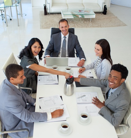 Business people shaking hands in a meeting photo