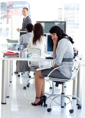Businesswoman getting bored in a presentation photo