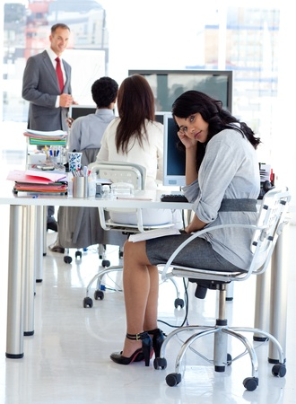 Tired businesswoman in a meeting photo