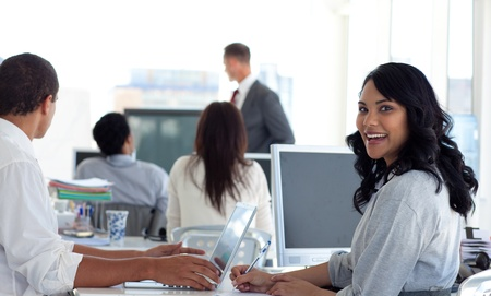 Businesswoman smiling in a presentation photo
