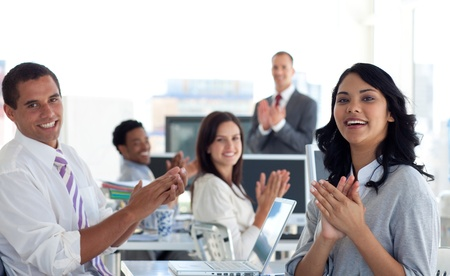 Businessteam applauding a colleague after a presentation Stock Photo - 10072645