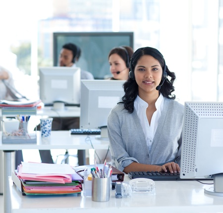 Beautiful businesswoman working in a call center Stock Photo - 10072356