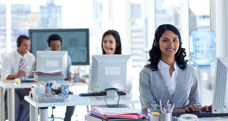 call center woman: Businesswoman with a headset on in a call center