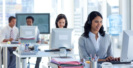 Businesswoman in a call center with her colleagues Stock Photo - 10073191
