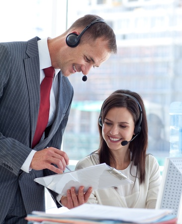 Manager talking to a businesswoman in a call center photo