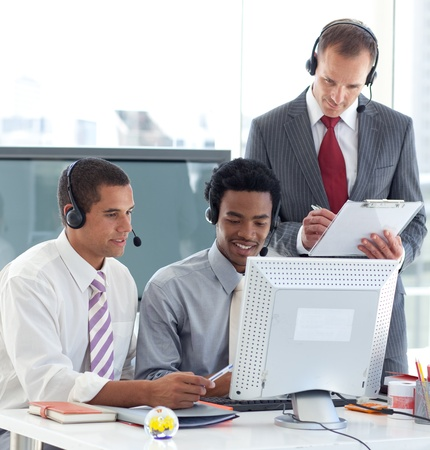 Manager and businessmen working in call center photo