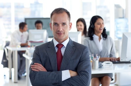 Confident manager leading his team in a call center photo
