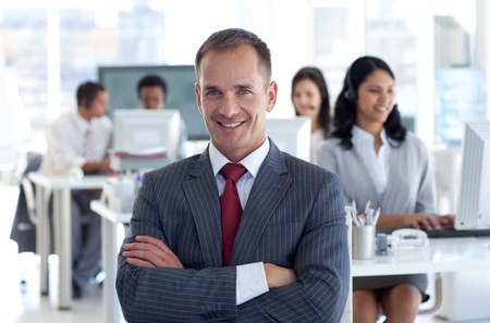 Smiling manager leading his team in a call center photo