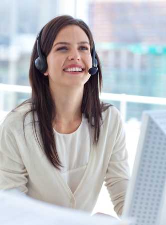 Portrait of a businesswoman working in a call center photo