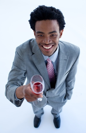 Smiling Afro-American businessman holding a glass of wine photo