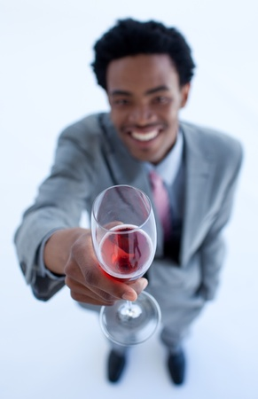 Afro-American businessman celebrating a success with wine Stock Photo - 10072168
